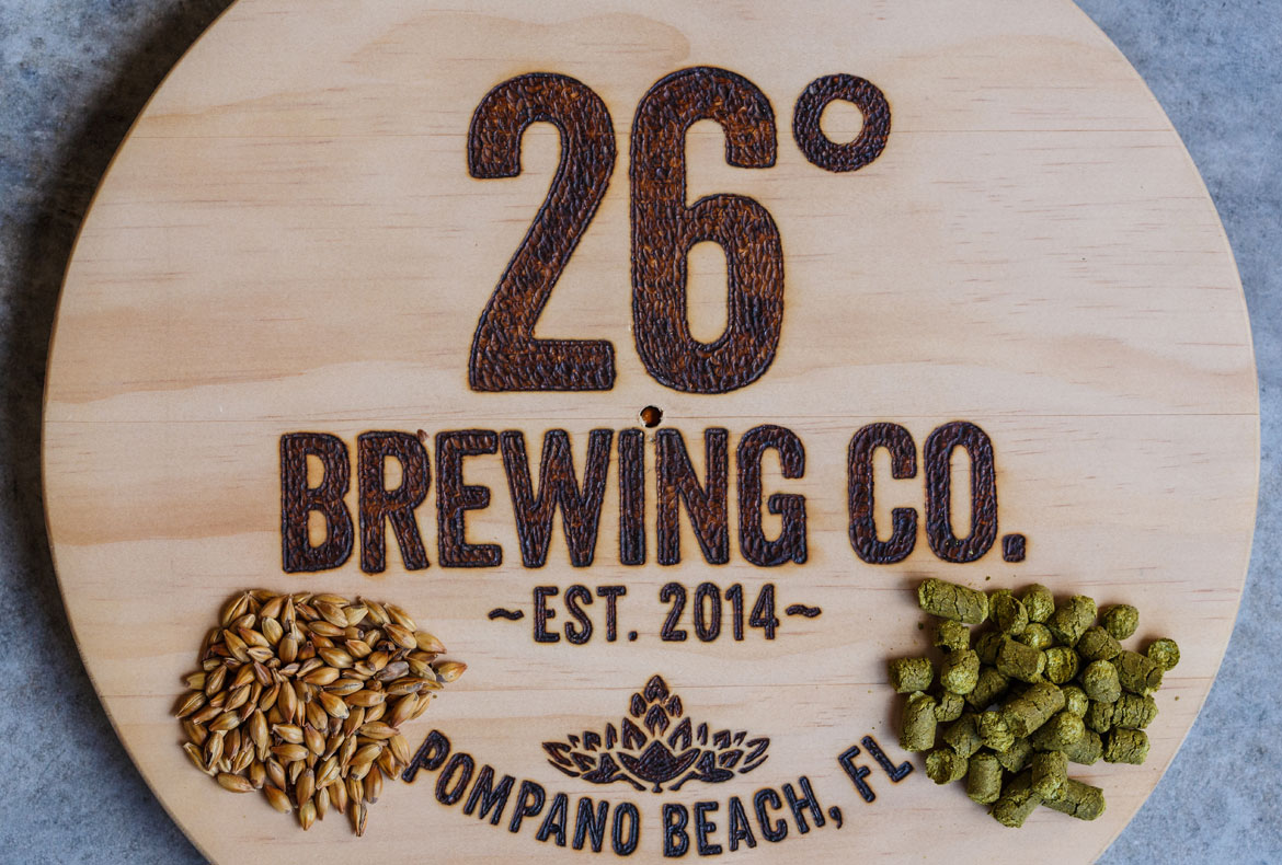 a photo of the 26 degree brewery logo on wood