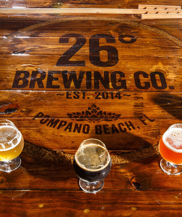 a photo of a wooden table at the 26 degree brewery